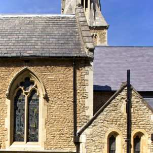 The completed chancel roof (right) in stark contrast with the aisle roof (left) which is in need of repair